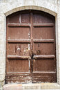 Free The Wooden Door On The Old Walls Royalty Free Stock Photo - 25555145