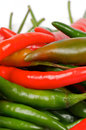 Free Arrangement Of Chili Peppers Royalty Free Stock Images - 25557959