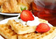 Tasty Breakfast - Tea, Croissants And Wafers Royalty Free Stock Photos