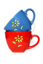 Free Red And Dark Blue Mugs With Yellow Flower Royalty Free Stock Photography - 25566087
