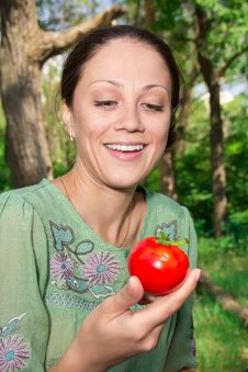 A Woman With A Tomato Stock Image