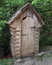 Free Old Outhouse In The Trees. Royalty Free Stock Photography - 25561107