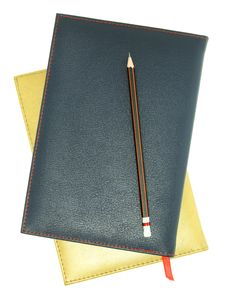 Free Stack Of Leather Notebook And Pencil Royalty Free Stock Photo - 25582355