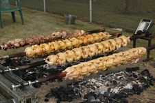 Free Spit Roasted Chicken And Pork Stock Photos - 25582903