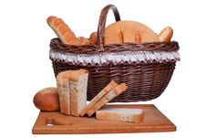 Bread On The Board Behind The Basket Stock Photography