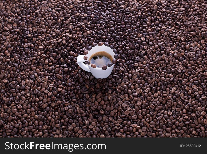 Coffee cup on a lot of coffee beans