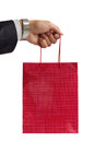 Free Businessman Holding Red Gift Bag Royalty Free Stock Photo - 25597175
