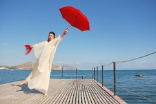 Free Girl With Red Umbrella Royalty Free Stock Photo - 2562995