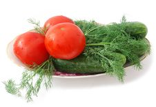 Tomatoes And Cucumbers Stock Images