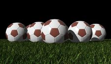 Free Brown Soccer Balls On A Green Grass Stock Photo - 25601890