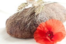 Whole Rye Bread And Wheat Ears Royalty Free Stock Photography
