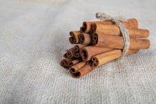 Closeup Of Cinnamon Sticks On Cotton Canvas Stock Photos