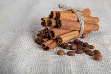 Free Cinnamon Sticks And Coffee Beans On Cotton Canvas Royalty Free Stock Photos - 25642968