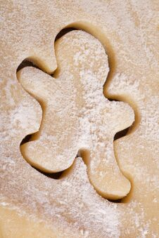 Free Cutting Cookies Dough Gingerbread Man Royalty Free Stock Photography - 25648307