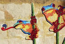 Painted Frogs On Concrete Wall Stock Photo