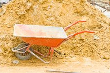 Free Wheelbarrow On The Background Of The Mound Of Sand Stock Photo - 25664040