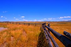 Free Grass Field With Wood Fence And Blue Sky Royalty Free Stock Photos - 25666808