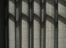 Free Shade On Grey Curtain Stock Photos - 25669213