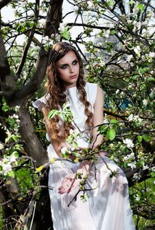 Blossom. Blooming Nature And Pretty Girl Sitting Royalty Free Stock Photo