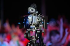 Free Film Camera In Front Of A Cheering Crowd Royalty Free Stock Image - 25672006