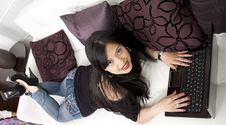Free Young Lady Sitting On Sofa Royalty Free Stock Photo - 25683025