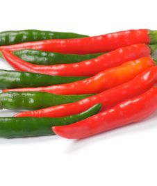Free Arrangement Of Green And Red Chili Peppers Royalty Free Stock Photos - 25689148