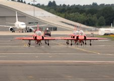 Free Red Arrows In The Jet Haze Royalty Free Stock Image - 25689356