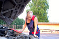 Free Beautiful  Woman Repairing The Car Stock Photo - 25695170
