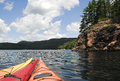 Free Three Kayaks Point To The Wilderness Stock Photo - 25695960