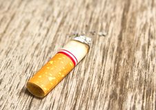 Free Cigarette On The Wood Floor Royalty Free Stock Photos - 25691528