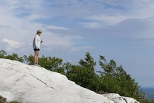 Free A Woman Stands High Above The Wilderness. Royalty Free Stock Photos - 25695818