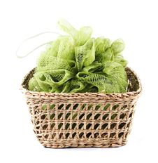 Green Bath Loofah In A Basket Royalty Free Stock Photos