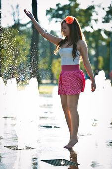 Free Girl Wearing Red Skirt Playing Water Fountain Royalty Free Stock Image - 25704426