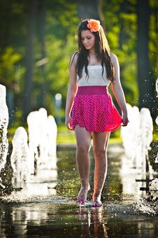 Free Girl Wearing Red Skirt Playing Water Fountain Stock Photography - 25704742