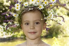 Free Happy Boy With A Wreath On His Head. Stock Photo - 25709390