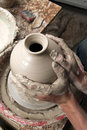 Free Hands Of A Potter, Creating An Earthen Jar Royalty Free Stock Image - 25718476