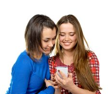 Free Two Girls Read Messages By Phone Stock Image - 25716021