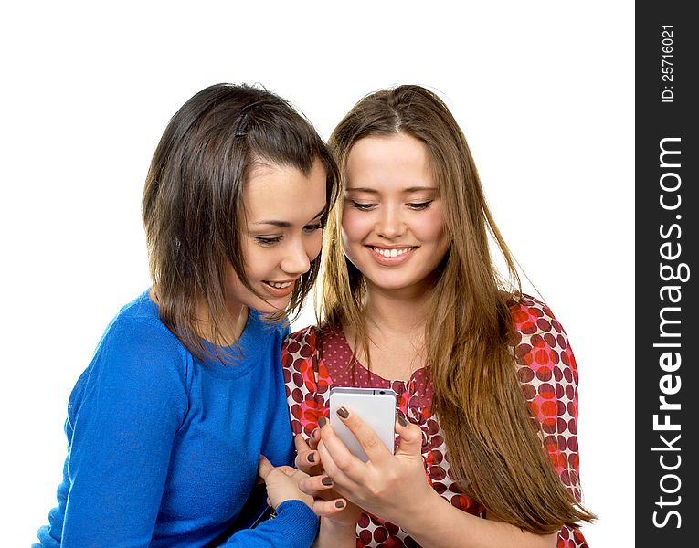 Two girls read messages by phone
