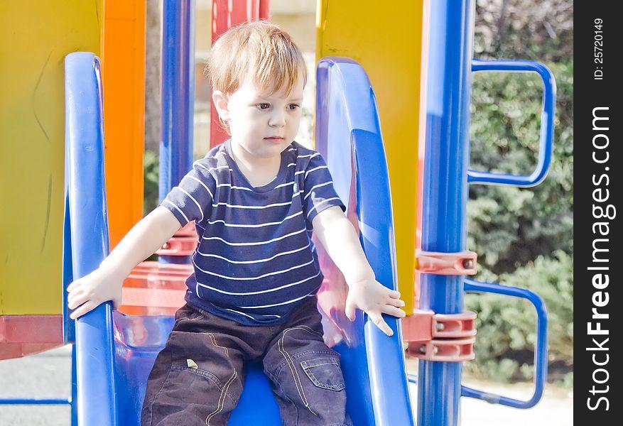 Small boy on a slide