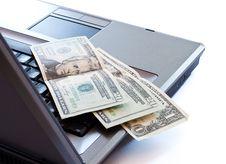 Dollars On Keyboard Stock Photo
