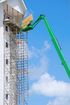 Free Construction Scaffolding And Lift On Tall Buiding Stock Photography - 25741752
