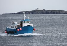 A Boat Returning To Harbour. Royalty Free Stock Photos