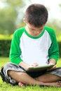 Free Boy Using Digital Tablet Stock Photos - 25750933