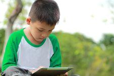 Free Boy Using Digital Tablet Stock Photos - 25750833