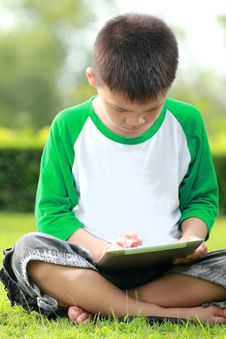 Free Boy Using Digital Tablet Stock Photos - 25750933