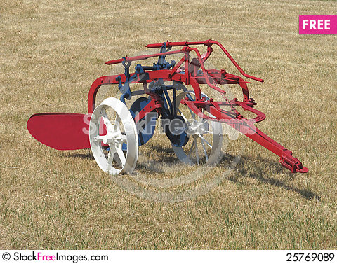 Free Old Farming Plow In A Field Isolated. Royalty Free Stock Images - 25769089