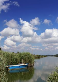 Free Little Blue Boat At The Lagoon Royalty Free Stock Photo - 25760315