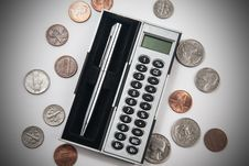 Free Calculator And Coins Royalty Free Stock Photography - 25764327