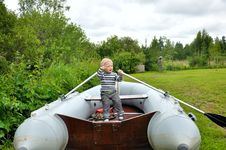 Boy  Rowing A Boat Royalty Free Stock Image