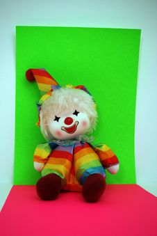 Rainbow Colored Clown Doll On Bright Background Royalty Free Stock Images